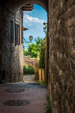 Medieval arched street in the old town of San Gimignano in Tuscany, Italy