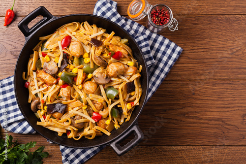Indonesian pasta with chicken, pieces of bamboo and mushrooms. - 257885381