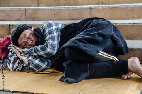 fototapeta na ścianę Homeless man sleep on street.