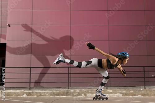 Professional beautiful woman roller skating