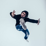 stylish rapper is dancing breakdance .photo on a white backgroun