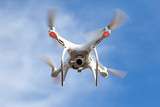 Flying drone with blue sky background, technology