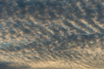 background texture of blue sky near dusk with heavy cloud in some pattern