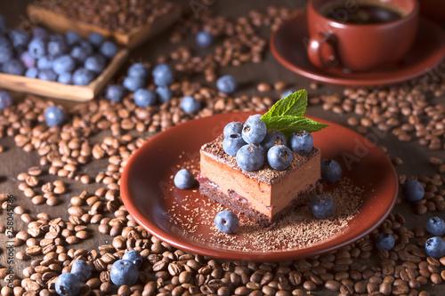 fototapeta na ścianę Chocolate cake with blueberries and mint .