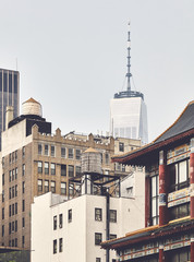 New York cityscape with water towers seen from Chinatown, color toning applied, USA.