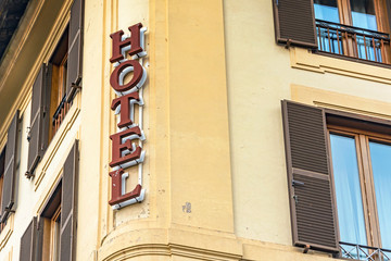 Hotel sign on wall facade