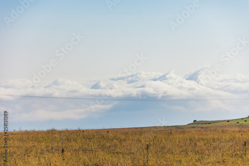 Above the clouds in the mountains - 258131389