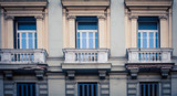 Three balconies on a building in Naples