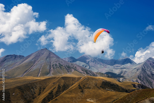 Paragliding in mountains. Extreme sport. Flight on paraglider over mountains of Caucasus. © monkographic