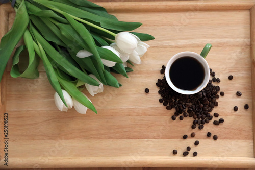 tulips and coffee on wooden board © Алена Новосельцева