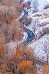 Curvy road on a snowy mountain in Salt Lake City © Jason