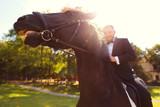 Fototapeta Fototapety z końmi - Handsome man posing with horse in nature © hreniuca