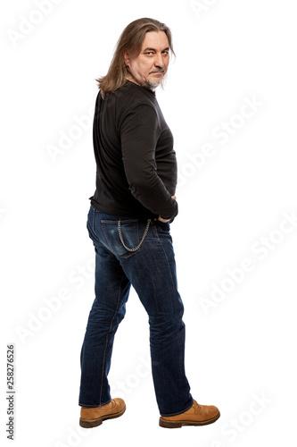 Leinwandbild Motiv Middle-aged man, full height. Isolated on a white background. Vertical.