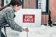 Leinwandbild Motiv Stylish experienced real estate agent working in winter
