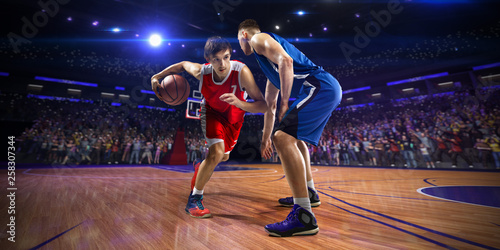 Fototapeten Basketball Basketball player n action. around Arena with blue light spot