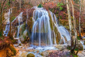 beautiful waterfall on the mountain river, spring scene