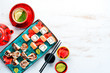 Sushi and maki rolls on a plate. Top view. Free space for your text. On a white background.
