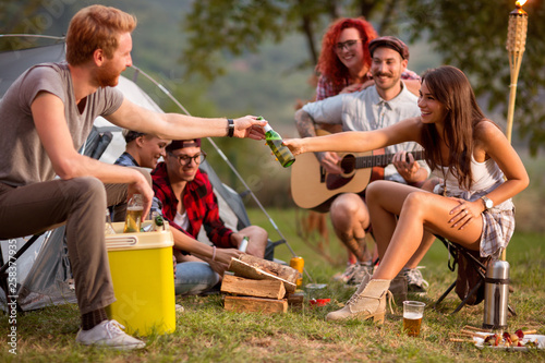 Girl add bottle of beer to boy - 258377935