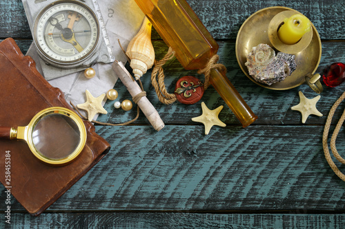 adventure and treasure hunt concept on wooden background