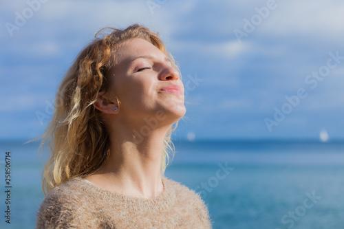 Leinwanddruck Bild Happy woman outdoor wearing jumper
