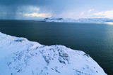 Dark February morning in the Bay of Teriberskaya Guba (shooting from a quadrocopter). Arctic, Russia