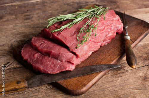raw beef meat on wooden background - 258512739