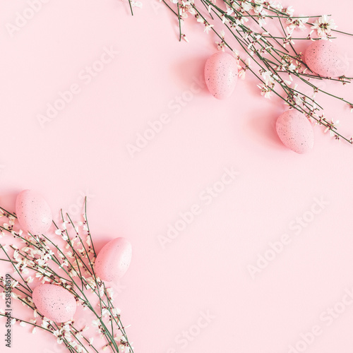 Easter composition. Easter eggs, white flowers on pastel pink background. Flat lay, top view, copy space, square - 258558519