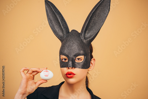 Easter woman. Happy easter. Lips and Easter, Lipstick kiss imprint on easter egg. Bunny woman. Girl with lace bunny ears.
