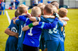Group Of Children In Soccer Team. School Football Coach's Pregame Speech. Coaching Youth Sports. Young Boys United In Football Team