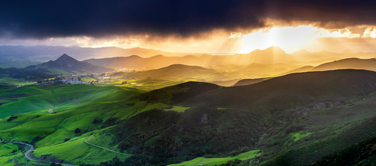 Panorama of Mountains and Sunlight and Hills