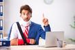 Leinwandbild Motiv Injured employee working in the office