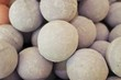 Close up photo of a stack of large, tan bath bombs at a wellness spa - 258635512