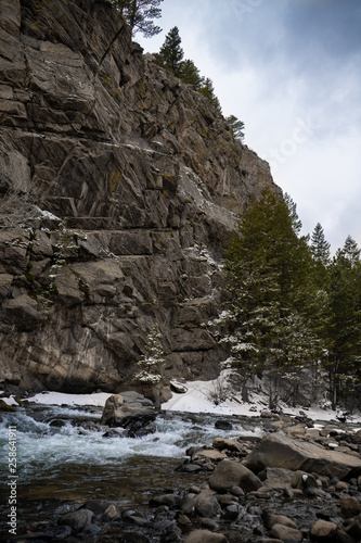 Colorado Rocky Mountains National Park. Bear Creek. Mountain river runs through the forest in the spring. Stones and rocks in the water - 258641911
