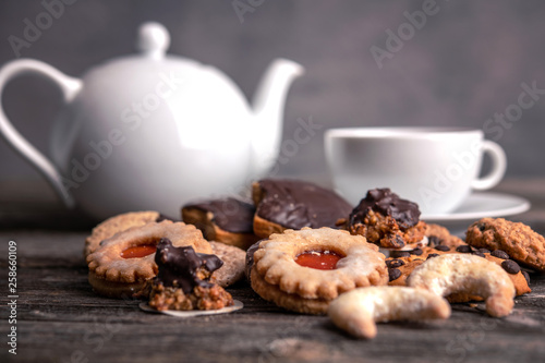 different homemade cookies with cup and pot of tea © Firma V