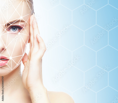 Leinwandbild Motiv Portrait of attractive woman with a scnanning grid on her face. Face id, security, facial recognition, future technology.