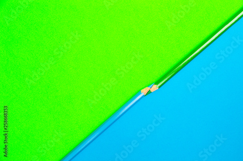 Color Pencils on Blue and Green Background. Coloring pencils for drawing. Colored Art Pencils. School and Office Supplies. Student Stationery. Abstract background. Colorful and creative. - 258668353