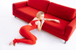 canvas print picture - Beautiful magnetic woman sitting near the sofa
