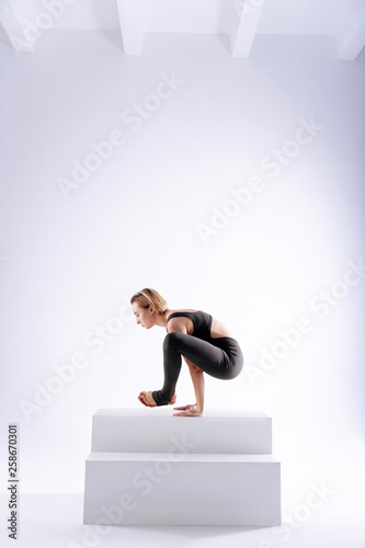 canvas print picture Beautiful good looking woman holding her body up
