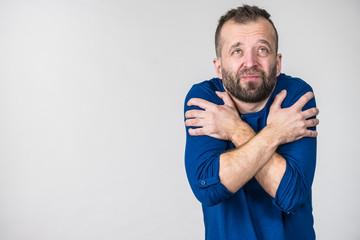 Man feeling cold gesturing