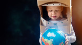 Kid with globe.