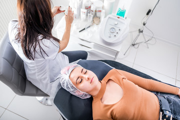 Young woman laying in beauty salon waiting for treatment