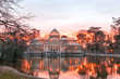 The Palacio de Cristal at sunset (Crystal Palace) is a glass and metal structure located in Madrid's Buen Retiro Park