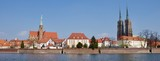 A panorama of a Wroclaw with church and a cathedral next to a river