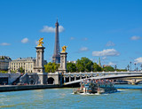 View of Alexandre III bridge and Eiffel Tower from Seine river. Paris, France