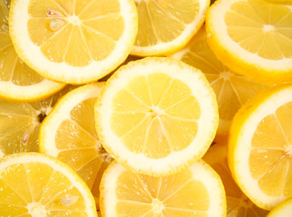 lemon wedges lies on a bright background
