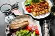 grilled shrimps and salmon steak with fresh vegetables and wine - 258751331