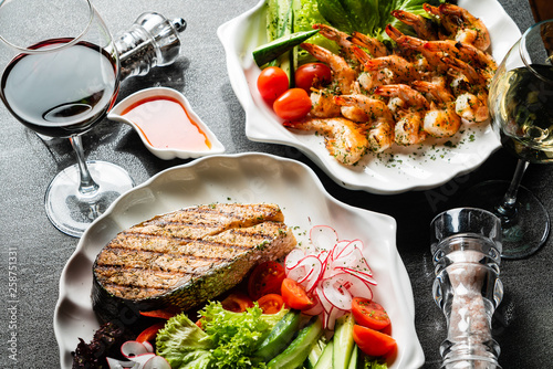 grilled shrimps and salmon steak with fresh vegetables and wine © Maksim Shebeko