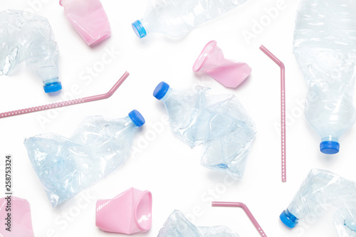 Crumpled single-use plastic waste, studio shot. Plastic pollution concept. Single-use plastic is a human addiction that is destroying our planet and impacts our waters, sea life and humans. © triocean