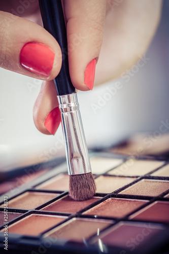 Leinwandbild Motiv Palette with eye shadows and brushes for face make up