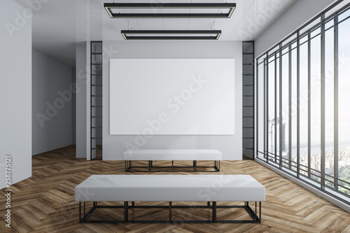 Leinwandbild Motiv Modern exhibition hall with empty billboard